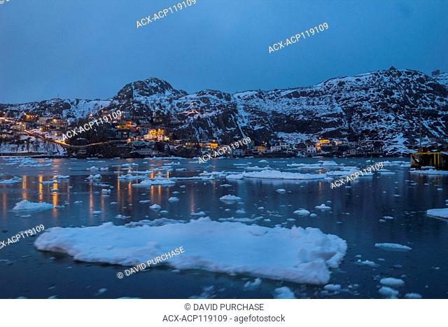 Looking over the narrows of St. John's harbour during winter, the quaint fishing village know as the Battery in the background, St