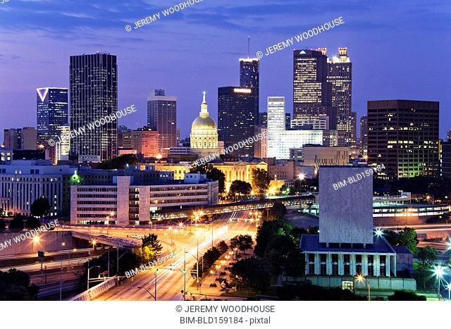 Highway traffic to Atlanta cityscape at night, Georgia, United States