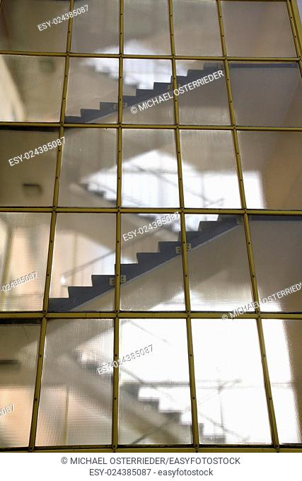 Stairs behind a glass wall. Modern architecture detail
