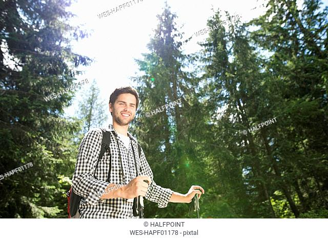Young man on a hiking tour in the forest