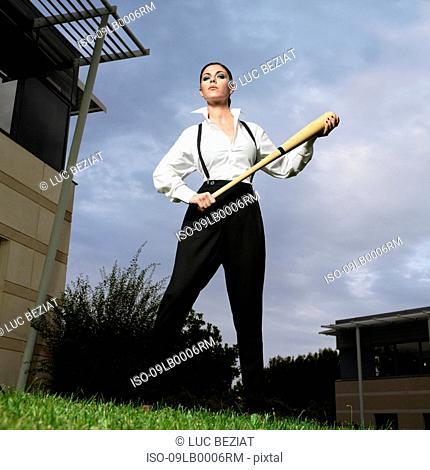 Businesswoman holding a baseball bat