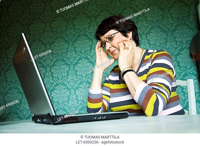 Middle-aged woman with laptop computer  Finland