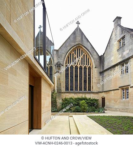 Modern facade in juxtaposition to Chapel window. The Garden Building at Lincoln College, Oxford, United Kingdom. Architect: Stanton Williams, 2015