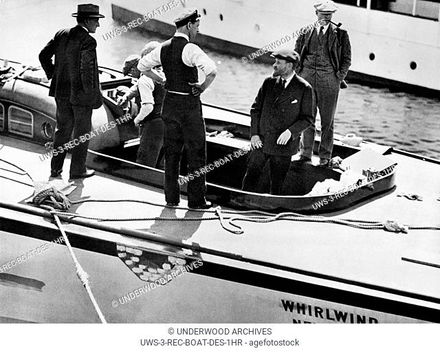Boston, Massachusetts: 1930 Famed yacht designer Francis Herreshoff (with beard) as he arranges for the placement of the main steering wheel on the new...