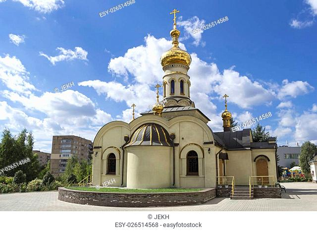 Temple of Xenia of St. Petersburg in Donetsk, Ukraine, 2016. Orthodox church. Golden domes and crosses under blue sky