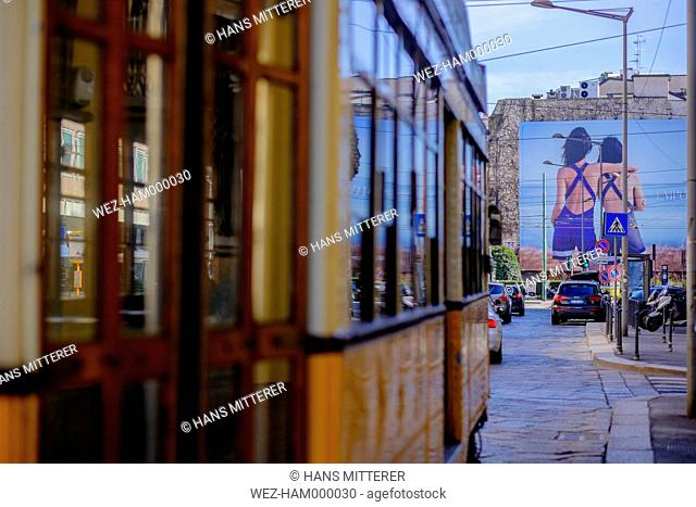 Italy, Milan, tramway and advertisement poster