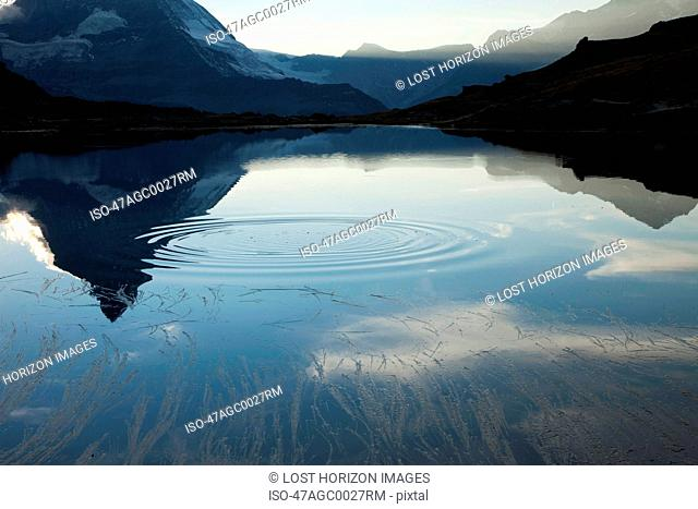 Ripple in still mountain lake