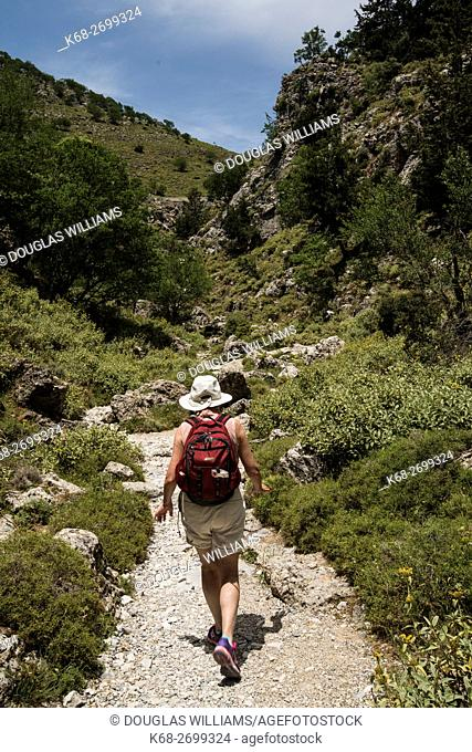 A woman walks up the Imbros gorge in Crete, Greece