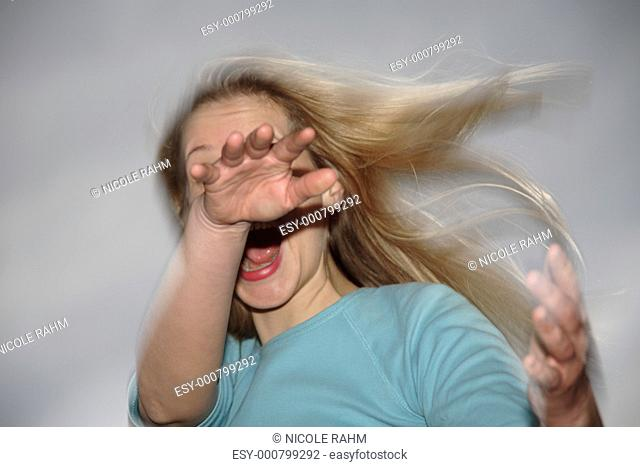 Young woman dancing, motion blur