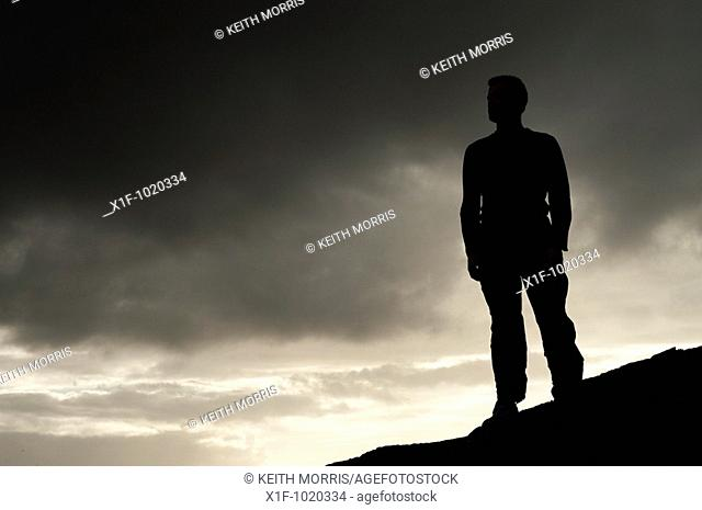 Silhouette of a man standing