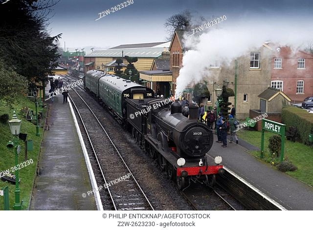 Ex LSWR Drummond T9 4-4-0 class locomotive number 30120 at Ropley station with a train for Alresford. The Mid Hants Heritage Railway also known as â