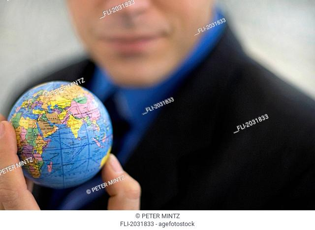 Cropped Businessman Holding World In His Hand