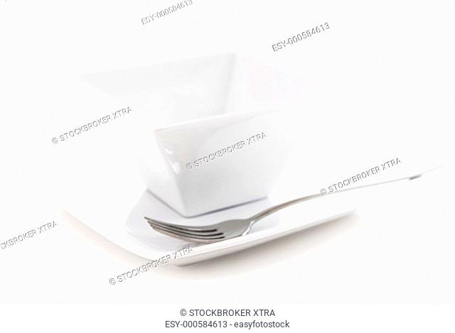 Place setting of white plate and bowl isolated on white background