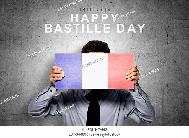 Businessman holding board with france flag color. Happy Bastille Day