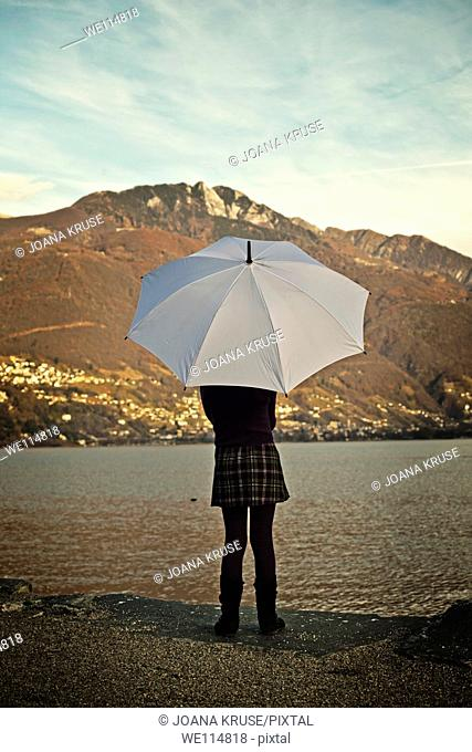 girl with an umbrella at the Lake Maggiore
