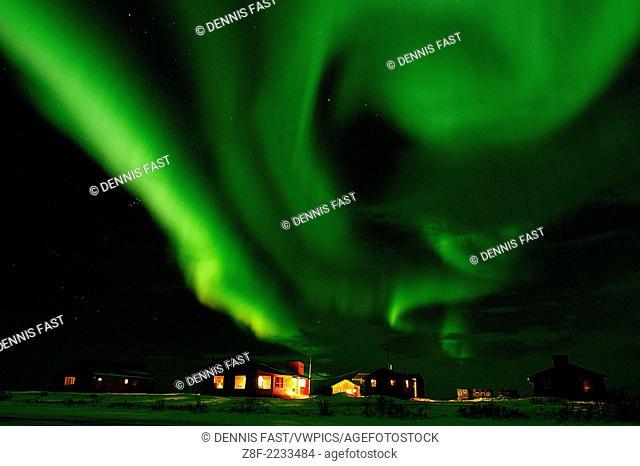 Aurora Borealis Northern Lights over tundra lodge at Dymond Lake near Churchill, Manitoba, sub-arctic, Northern Canada