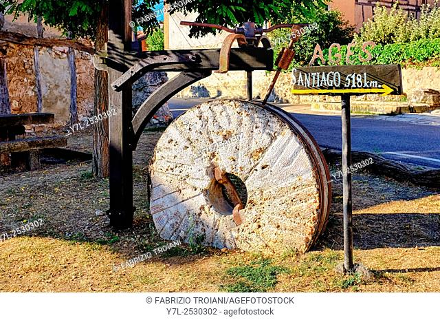 Stone grinding wheel in Agés with directions for the Way of Saint James (Camino de Santiago), Castile and León, Spain