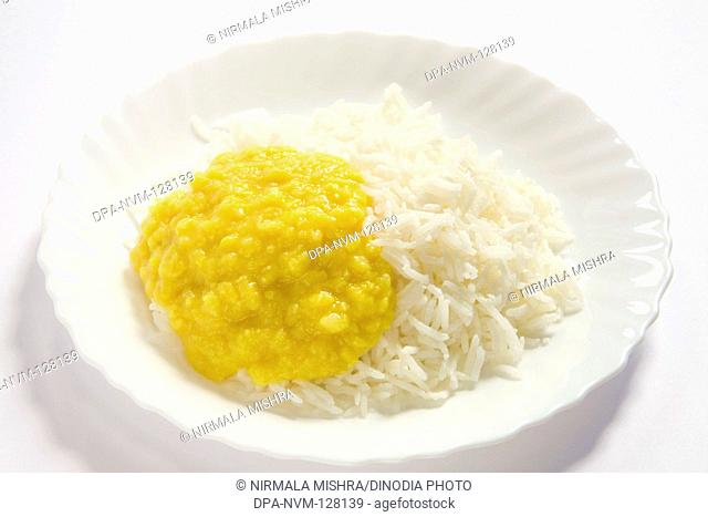 Vegetarian , Indian cuisine dal bhath boil basmati rice bhath chaval oryza sativa and moong dal mung beans phaseolus aureus served in plate