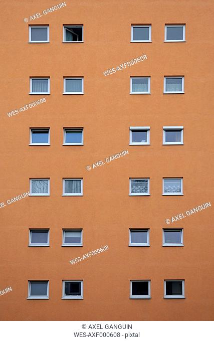 Orange house facade with squared windows