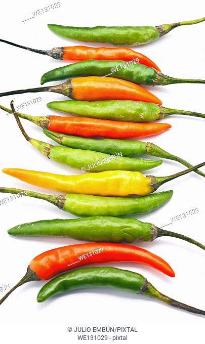 "bunch of chillies """"green"""" spicy, in white base"