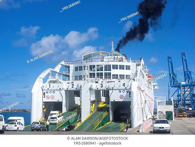 Black smoke from funnel of Naviera Armas ferry as cars board for journey to Tenerife. Puerto de La Luz, Las Palmas, Gran Canaria, Canary Islands, Spain