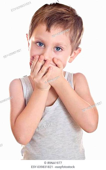 Sad boy covers his mouth palms