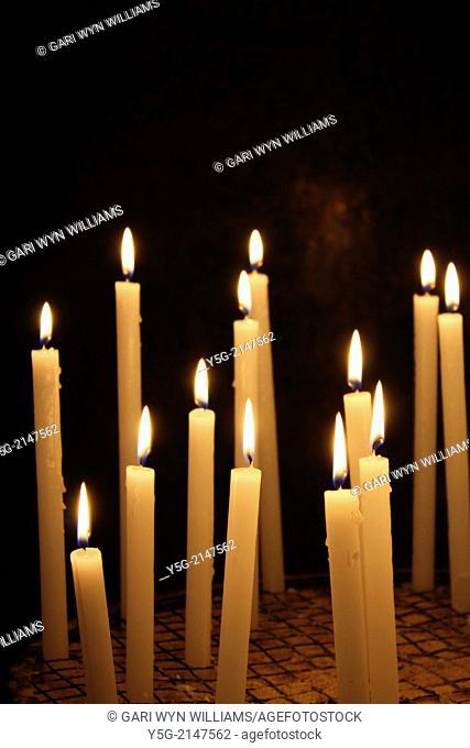 Many candles inside santa maria in trastevere church in Rome Italy