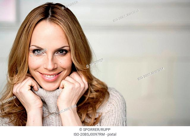 Woman in turtleneck jersey smiling