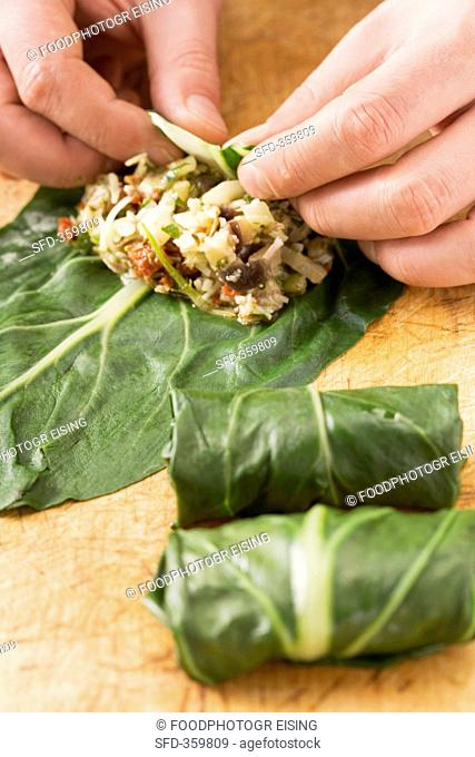 Chard roulade with an aubergine filling being prepared