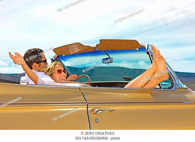 Happy couple in convertible