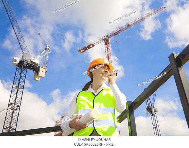 Woman using Walkie Talkie by Cranes