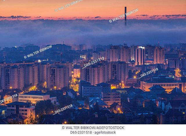 Romania, Transylvania, Brasov, new city and CET Brasov thermal energy plant, dawn