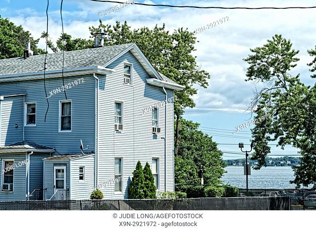 Bronx, New York, City Island. Looking at the Waterfront View from a Side Street, Past the Side of a Waterfront Home