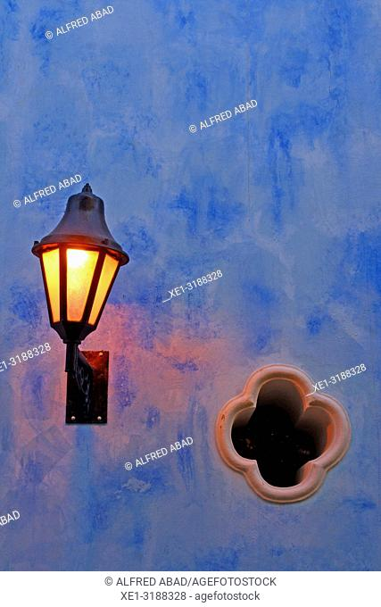 street lamp on blue wall, Cartagena de Indias, Colombia