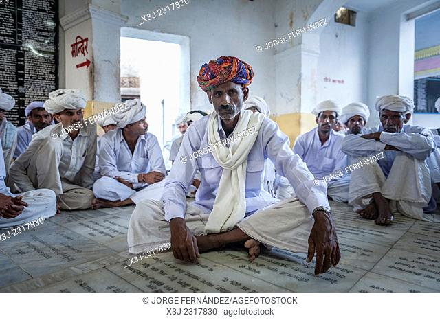 Men dressed with traditional colourful turbans inside a temple, Pushkar, Rajasthan, India