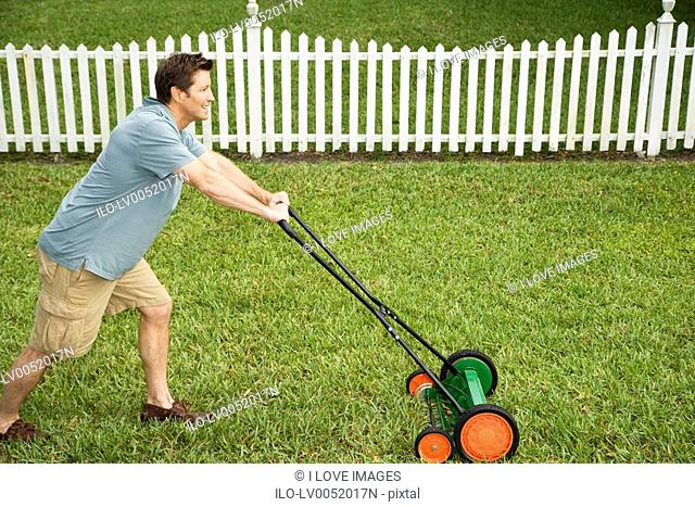 man mowing the lawn\n