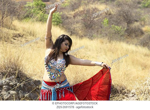 Lady belly dancer posing in a Tribal Fusion dance, Pune, Maharashtra, India