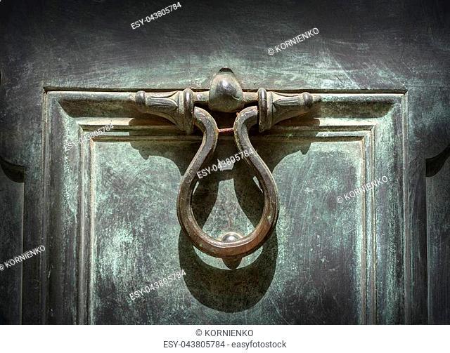 antique door-knocker on old door background
