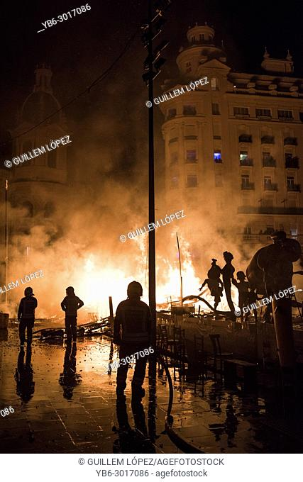 "Firefighters at work during the night of """"La Crema"""" the burning at the Valencian town hall square as part of the last day of las Fallas festival in Spain"