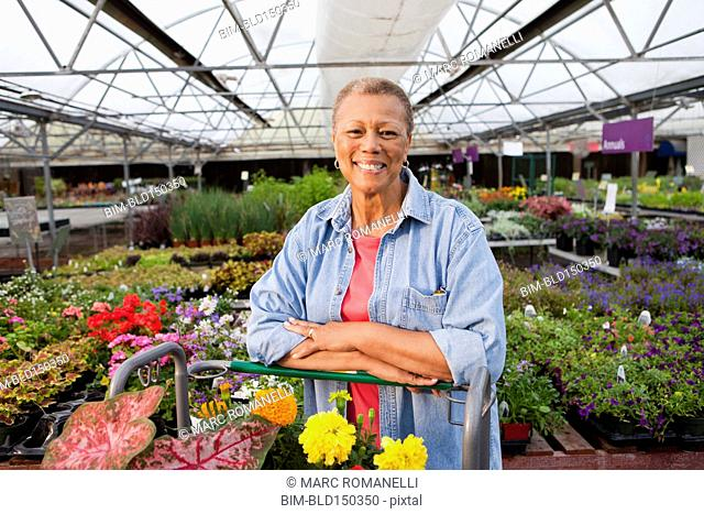 Mixed race woman working in plant nursery