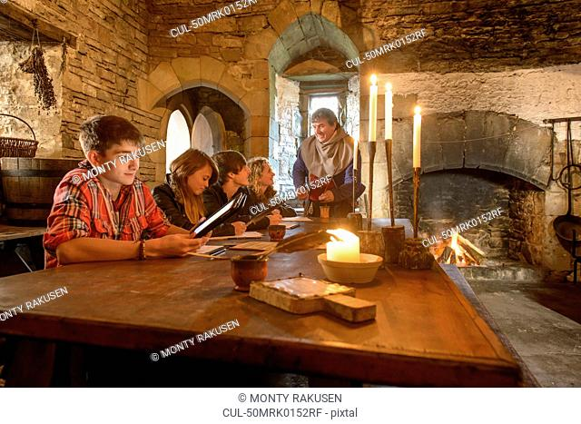 Students reading history in castle