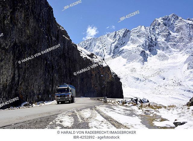 Truck on snowy Death Road, Camino de la Muerte, La Cumbre Pass, road between La Paz and Coroico, Bolivia