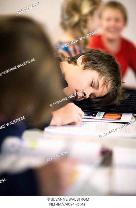 Boy sleeping in the classroom, Sweden