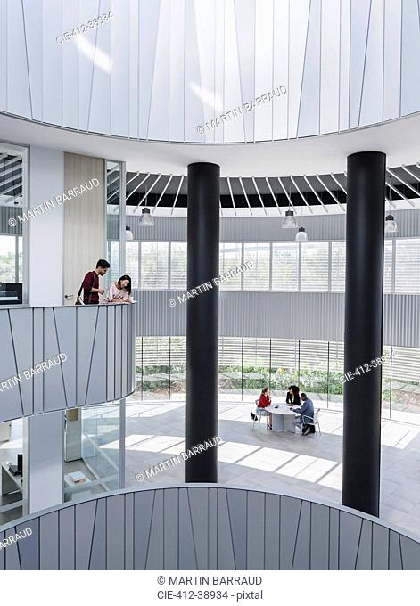 Business people meeting on architectural, modern office atrium balcony