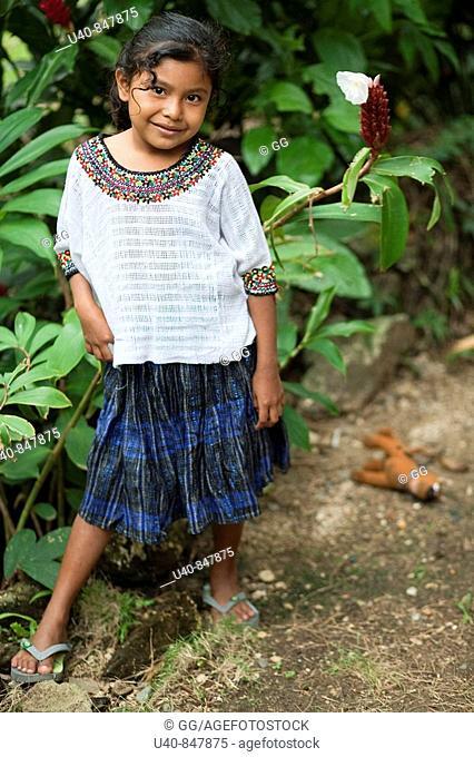 Guatemala, Rio Dulce, 7 year old girl posing