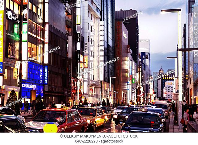 Tokyo city streets filled with taxi cabs at dusk. Ginza, Tokyo, Japan 2014