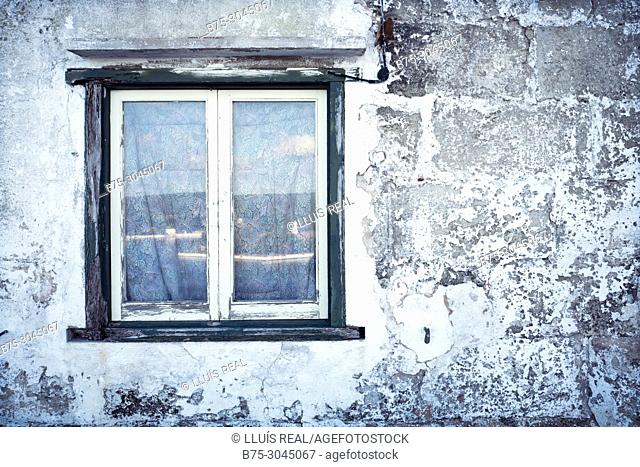 Old window with the port reflected on glass. Puerto de Mahon. Menorca, Baleares, Spain