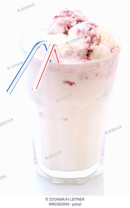 Milkshake with vanilla and cherry ice as closeup in a glass