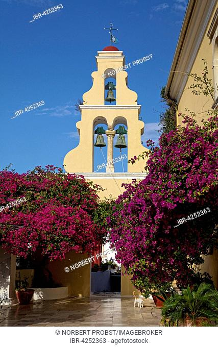 Courtyard with tower and bougainvillea, monastery of Panagia Theotokos tis Paleokastritsas or Panagia Theotokos, Paleokastritsa, Corfu, Ionian Islands, Greece