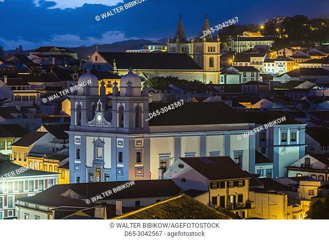 Portugal, Azores, Terceira Island, Angra do Heroismo, elevated town view with Igreja da Misericordia and Santissimo Salvador da Se churches, evening